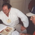 Tom Yax & Wally Young going over photos and after action reports.