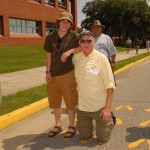 Bill Bisbee and his grandson stand in the yellow footprints