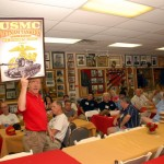 John Wear hocking the official reunion poster during the auction