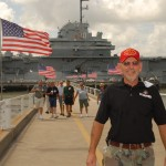 Wally Young with the USS Yorktown behind him