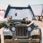 Jim Swinnie and Dick Kurst doing some 1st echelon maintenance on S4 jeep